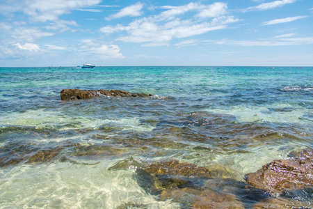 Sandy beach with rocks and crystal clear water in Thailand Stock Photo