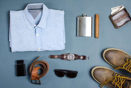 Male clothes and fashion accessories on blue background flatlay Stok Fotoğraf - 74041895