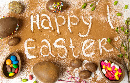 Easter note written in cacao powder with chocolate eggs