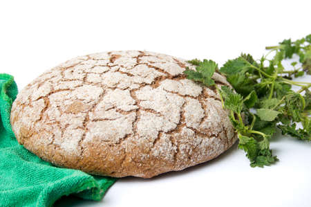 stinging  nettle: Rye bread loaf with stinging nettle leaves Stock Photo