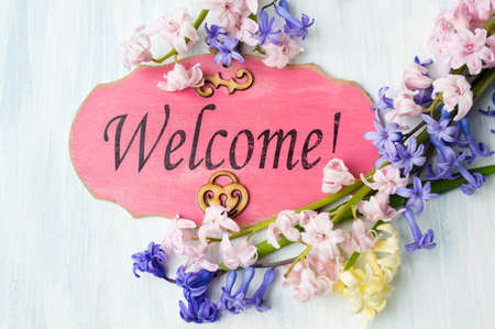 Welcome note and colorful hyacinth flowers arrangement