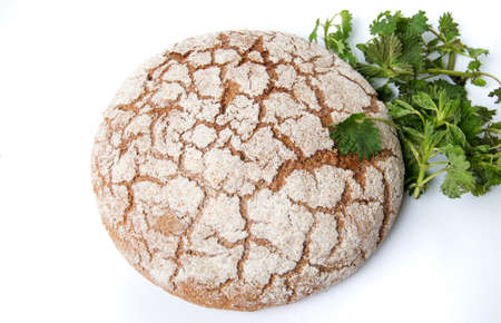 Rye bread loaf with stinging nettle leaves Stock Photo