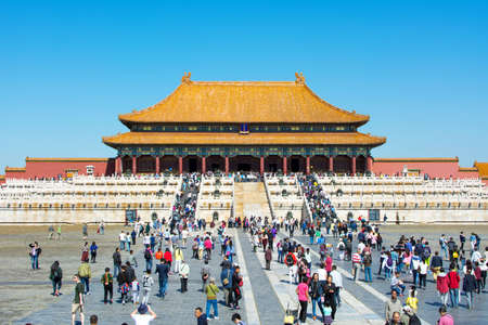 museum visit: BEIJING, CHINA - SEPTEMBER 29, 2016: Forbidden city  imperial palace plateau with many tourists visiting on a sunny day