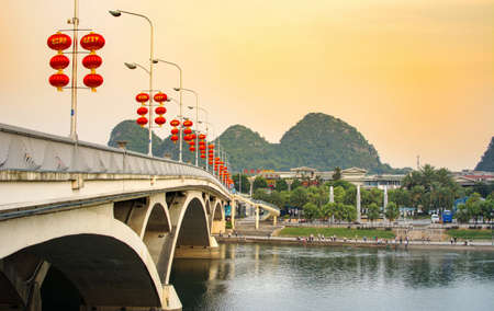 sky lantern: GUILIN, CHINA - SEPTEMBER 22, 2016: Bridge over Li river in the city central area decorated with Chinese red lanterns Editorial