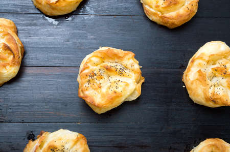 serbian: Homemade cheese pie rolls covered with sesame on a table Stock Photo