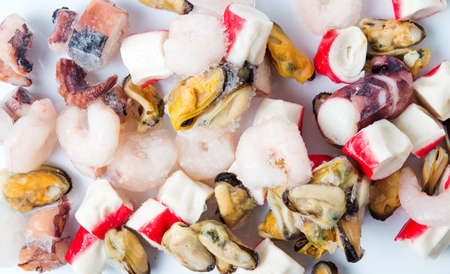 white washed: Frozen seafood mix of shrimps, surimi mussels and octopus top view