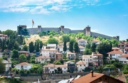 OHRID, REP. OF MACEDONIA - AUGUST 6, 2016: The walls of Samuel Fortress above old houses of Ohrid old town