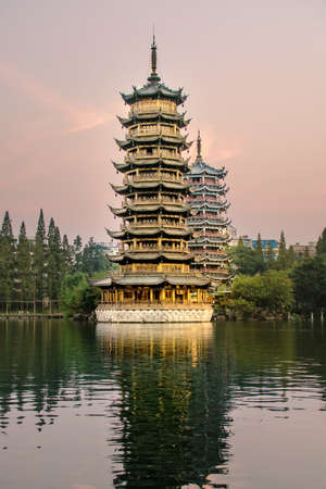Two towers in Guilin city, China at sunset time Editorial