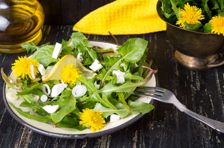 Dandelion salad with onions and cheese on a plate