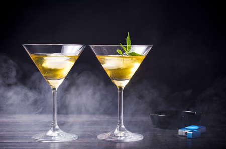 Two cocktails with marijuana against black background 版權商用圖片