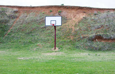 serbia: Basketball field covered with grass in the countryside Stock Photo