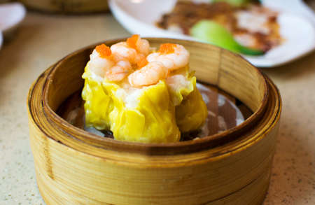 Chinese dimsum shrimp shao mai on bamboo steamer
