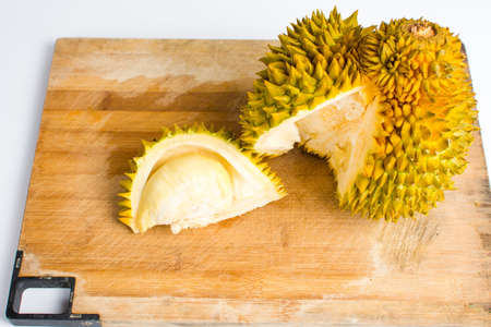 Durian fruit slice with peel on a wooden board Stock Photo