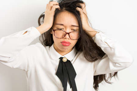 Tired young asian business woman with glasses Stock Photo