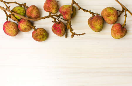 Lychee tropical fruit on a wooden table