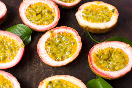 halved  half: Bunch of halved passion fruit on a wooden board