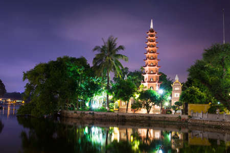 HANOI, VIETNAM - MAY 22, 2017: Tran Quoc pagoda, the oldest Buddhist temple in Hanoi, built in sixt century and located on a small island in the West Lake