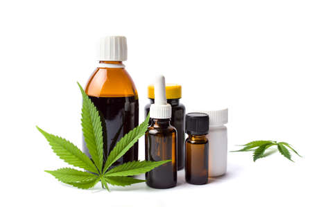 narcotic: Marijuana plant and cannabis oil bottles isolated