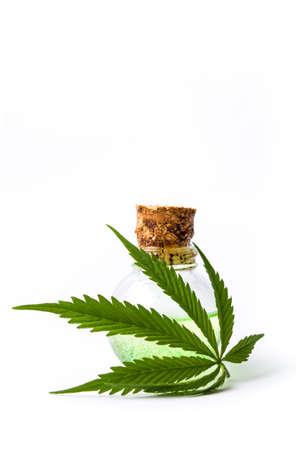 legalize: Marijuana leaf and cannabis oil bottles isolated on white