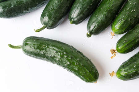Freshly washed cucumbers on white wooden table Reklamní fotografie