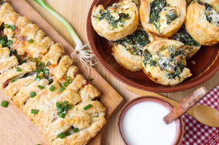 Homemade puff pastry with pizza ingredients and spinach