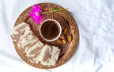 Halva dessert and Turkish coffee on a tray Stock Photo