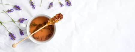 Lavender tea with fresh flowers and brown sugar stick