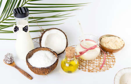 Various coconut products collection against white background
