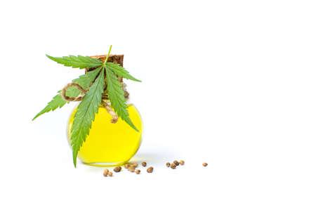 Marijuana leaf and cannabis oil isolated on white