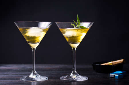 Two cocktails with marijuana against black background 스톡 콘텐츠