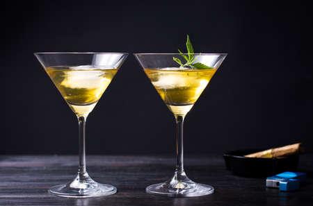Two cocktails with marijuana against black background Foto de archivo