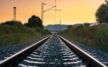serbia: Vintage empty railroad at romantic sunset time