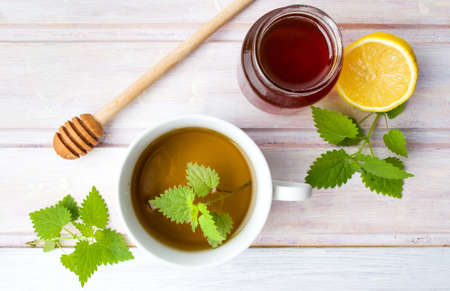 Stinging nettle tea with honey and lemon top view Stock Photo