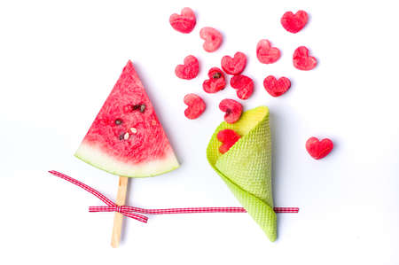 triangle shaped: Watermelon fruit slice on a stick with ice cream cone
