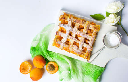 cutting: Sweet fruit pie slice with apricot on a plate Stock Photo