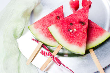 Watermelon fruit slice on a ice cream stick on a plate