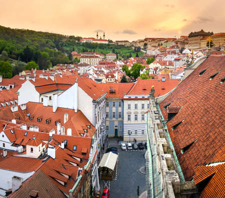 above 18: PRAGUE, CZECH REPUBLIC - APRIL 18, 2017: Lesser Town Square rooftops with Prague cityscape with characteristic architecture from above