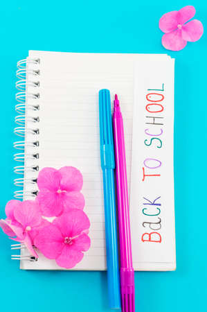 Back to school note written on a notebook page