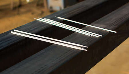 Welding electrodes on the big piece of metal Imagens