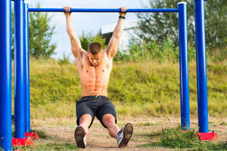Man stretching out after a street workout