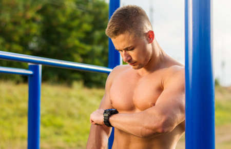 Man measuring time on during a street workout Stock Photo