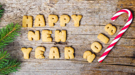 Happy new year note written with cookie letters Banco de Imagens - 85361182