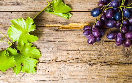 Purple grape on a rustic wooden background Stock Photo