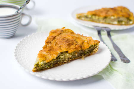 Homemade triangle pie slice with cheese and spinach