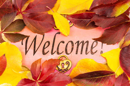Welcome note and fallen autumn leaves