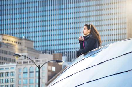 Female tourist looking at Chicago cityscape from the viewpoint Stock Photo