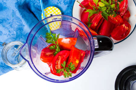 detoxing: Tomato slices in a blender for a healthy smoothie Stock Photo