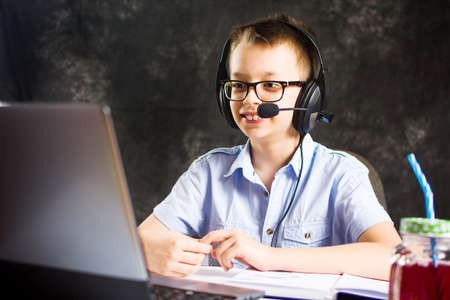 Teenage boy having a video call with headset