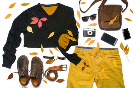 combination: Autumn male fashion accessories and fallen leafs