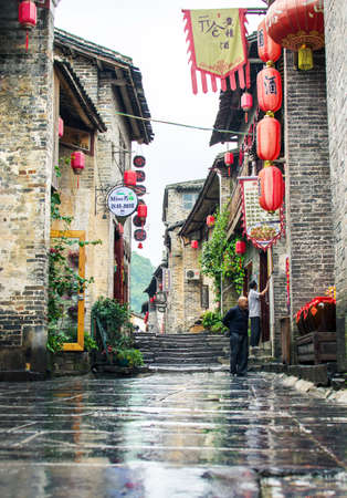 HUZHOU, CHINA - MAY 3, 2017: Huang Yao Ancient Town in Zhaoping county, Guangxi province. Traditional Chinese architecture and street decoration Editorial